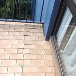 broken tiles on balcony