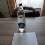 warm welcome letter with bottle of water and chocolates