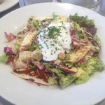 Caesar Salad topped with runny poached egg .. yum