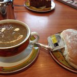 Freshly blended mushroom soup with bread roll.