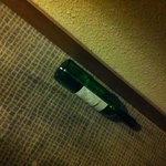 Empty wine bottle (not mine!) found in room.