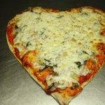 A heart-shaped pizza