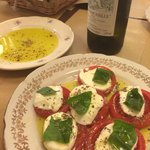 Local oil and a Caprese salad