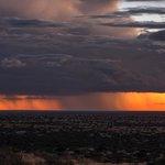 Wonderful storm sweeping past the vast plain