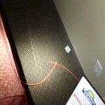 Behind the sleeper sofa