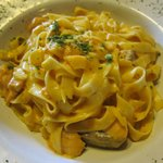 Tagliatelle pasta with salmon in lobster shrimp sauce