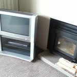 Ye ole TV & fireplace that had not been cleaned out