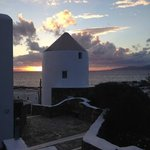 Windmill at Porto Mykonos hotel at sunset