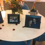 Placement of the pictures with bouquet and champagne