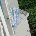a beach towel that looks like it has been on the ledge for months, so much mold on it..
