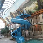 Water slide in courtyard with dining area in background