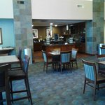 down stairs lobby dining area with family kitchen feel