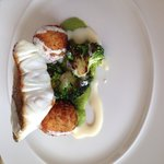 Roast hake with pea purée, fish bon bons and broccoli