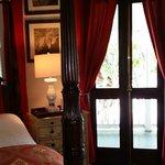Caribbean Queen bed and porch door