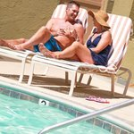 Couple Lounging by WCR Pool