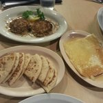 blue crab cakes and saganaki with pita bread