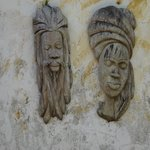 Carved heads at the Hope House