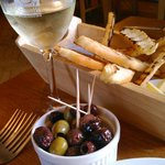 Olives, bread and Pinot Grigio