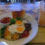 Veggies, Fried Eggs, Hashbrowns, Beans, and a Zest Ginger Juice