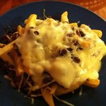 Fries con Papas (spiced mexican sausage) with cheese and queso