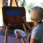 Participant painting outdoors