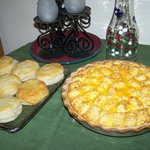 Breakfast quiche (with sausage or ham), biscuits, jelly and juice