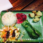 Fresh fish wrapped in banana leaf, beetroot curry, with rice and salad with mango dressing