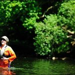 A Canoeist taking a dip in the Wye