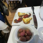 Kitchen´s greeting, olives and sandwich-like nibbles