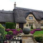 Fairy tale thatch-roofed house in the Cotswolds.