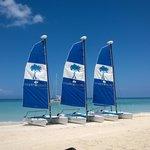 Couples sail boats