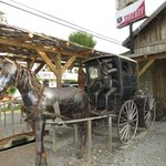 Outside metal sculpture (from local artist) with authentic carriage