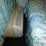 airconditioning unit next to bed