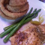 Salmon with sides of asparagus and onion rings