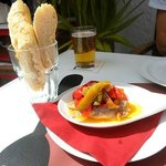 Fish, peppers, olive oil and fresh bread