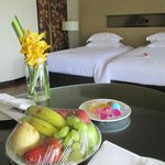 Welcoming orchids, fruits, and sweets.