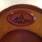 Disney characters on the bed headboard