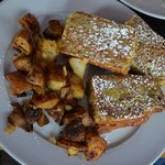Homemade banana bread french toast with home fries