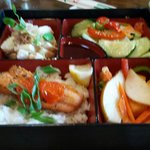 Bento box lunch, basil-soy salmon, pear salad, wasabi potatoes, cucumber sunomono.
