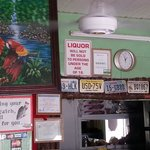 Regulars' old license plates adorn the wall, and they will cook your catch for you as well.