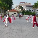 Locals dancing on the riverfront.