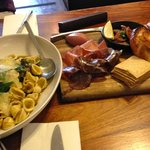Pasta with braised lamb and mushrooms;and the charcuterie board