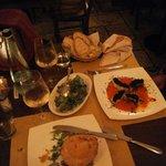 Medaglione di maiale in baule si pane e crema ai porcini e baccalà con crema di peperoni e olive