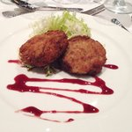 Catered dinner: crab cakes with pomegranate reduction