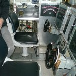 Get your hands on the submarine's steering wheels
