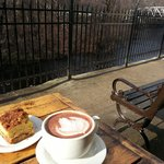 Great views from the outdoor seating with artistic hot chocolate (sadly the taste was not as ama