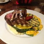 Rack of Lamb on a bed of Hatch Chile Mashed Potatos with grilled veggies