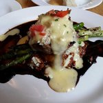 Filet topped with crabmeat and asparagus over red potatoes