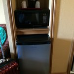 Fridge and microwave in room