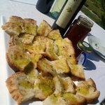 Local Bread with Genuine Olive oil, local honey and fresh herb!